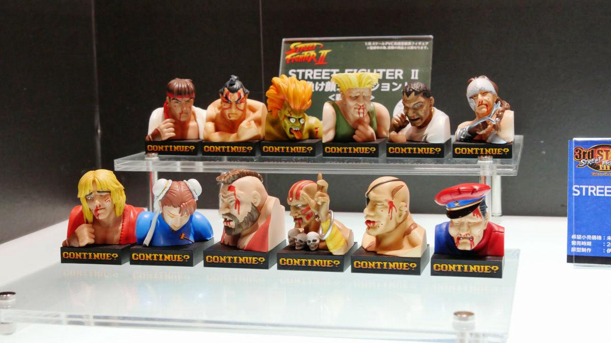 Busto dos lutadores derrotados no Street Fighter II